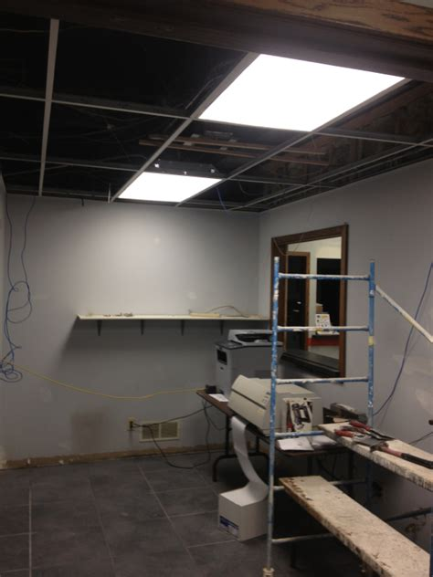 Removing Ceiling Tiles by Archives Complete Service