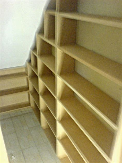 under stair shelving best 20 shelves under stairs ideas on pinterest