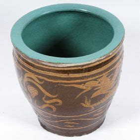 100 floors two eggs a clay floor pot with sculpted and glazed design