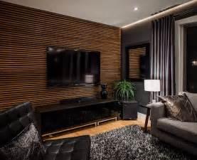 wohnzimmer holz modernes wohnzimmer schwarz mit tv wanpaneel holz und