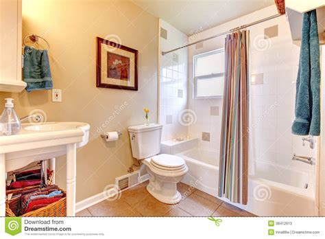 Refreshing Bathroom With White Tub And Beige Tile Floor
