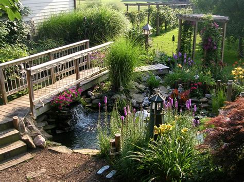 hgtv backyard designs scene of serenity a bridge crosses two connecting ponds