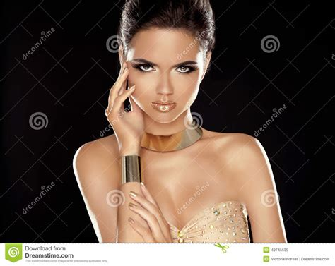 fashion beauty girl with golden jewelry vogue style