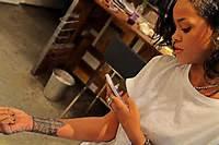 Rihanna Shows Off New Cross Tattoo  Path MEGAzine