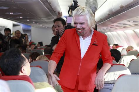air asia bet richard branson serves as airasia stewardess after losing