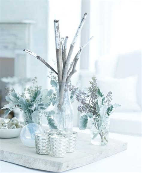17 white and silver christmas decorations creating a
