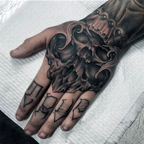 hand tattoo designs for men 80 skull designs for manly ink ideas