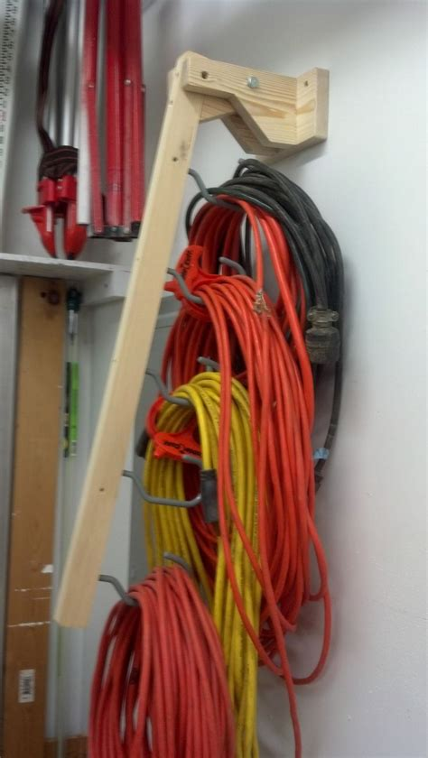 extension cord holder part   bike hooks screwed