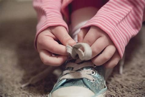 kid tying shoes 21 educational activities for who are stuck indoors