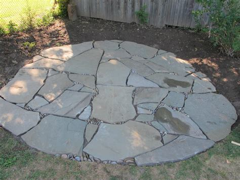 stone patio learn about installing finishing touches for a flagstone patio diy network blog made remade