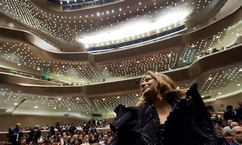 Zaha Hadid in the auditorium of her Guangzhou opera house