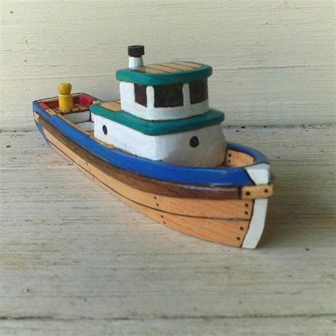 toy boat fishing blue green tow bit toy wooden boat