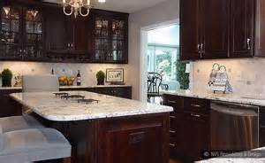 Travertine backsplash tile cream countertop dark brown cabinet