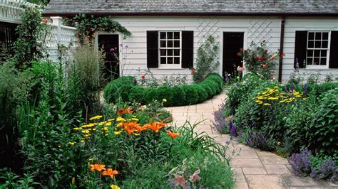 in a cottage garden cottage garden wallpaper 459933