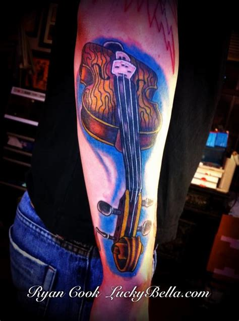 violin tattoo by ryan cook of lucky bella tattoos in