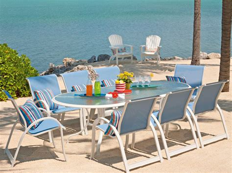 Telescope Casual Patio Furniture Telescope Casual Glass Top 43 X 75 Oval Dining Table With Umbrella 3460