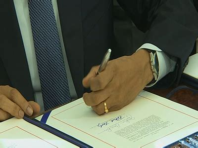 Obama Background Check Bill Obama Signs Bill To Rev Child Care Aid