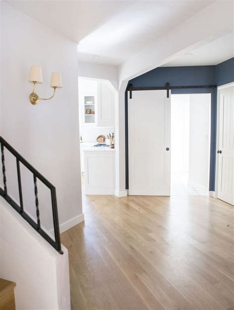 natural oak flooring with white walls emily henderson