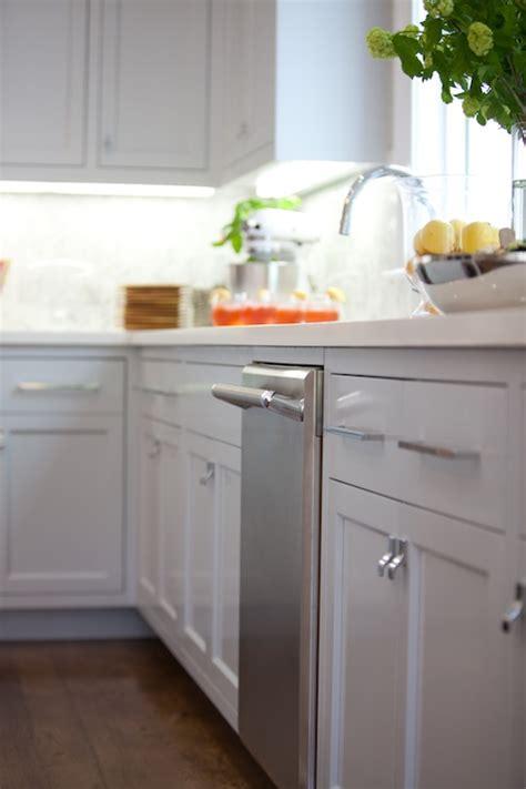 gray distressed kitchen cabinets with marble herringbone herringbone backsplash contemporary kitchen benjamin