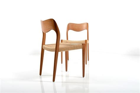 pair of dining chairs by n o moller room of