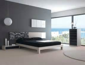 bedroom with black and white bed grey walls and bedroom