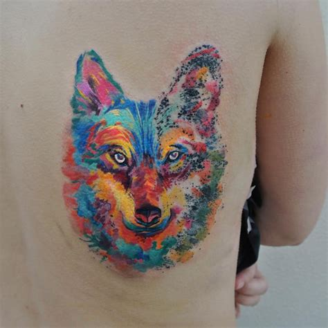 watercolor wolf tattoo wolf and forest tree on back shoulder