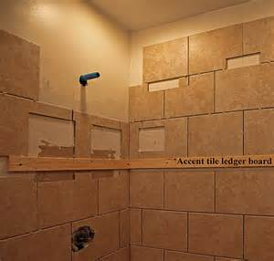 Recessed niches soap dish and accent strip set comfortably at approx