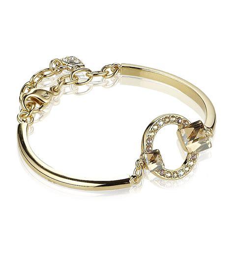 geometric bangle swarovski geometric bangle in gold lyst