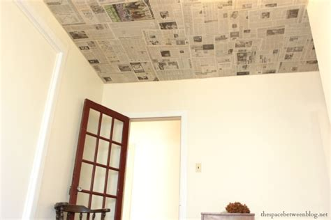 Creative Ceiling Coverings - newspaper as a creative wall covering