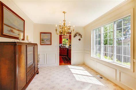 large bright beige dining room  cherry hardwood stock