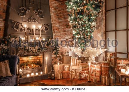 alternative home decor christmas tree in modern home with snow falling outside