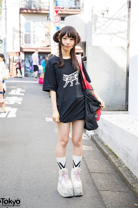 who is the tall girl wearing the pink skirt in liberty mutual commercial harajuku girl w undercover skeleton cat t shirt buffalo