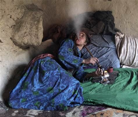 persian men in bed opium addiction ravages afghan families health
