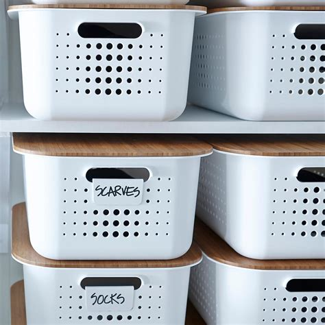 white with baskets white nordic storage baskets with handles the container