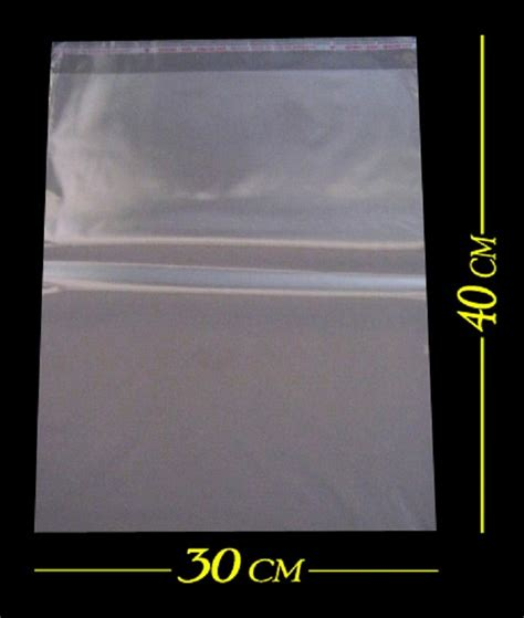 Plastik Opp Lem 30 Cm X 35 Cm jual plastik kemasan baju jaket celana jilbab opp perekat packing olshop grosir sumber plastik