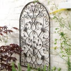 Wrought Iron Outdoor Wall Decor by Wrought Iron Wall For The Garden