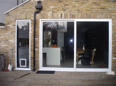 White Sliding Aluminum Door With A Large Glass For The Sliding Aluminum Patio Doors