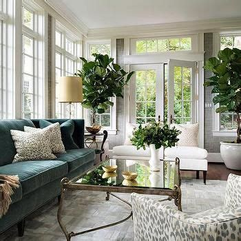 sliding french doors living room with green sofa and 25 best ideas about transitional living rooms on