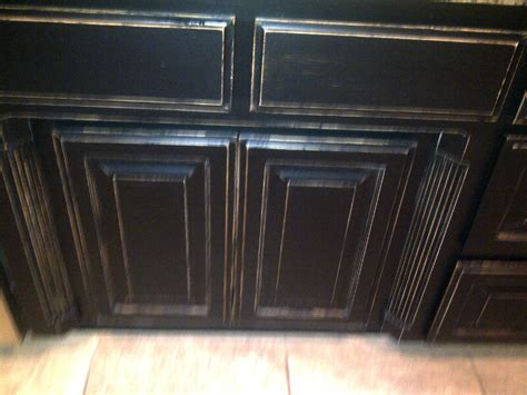 talkin trash to treasure black distressed cabinets