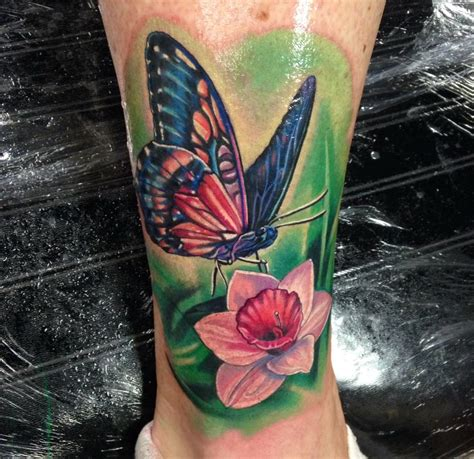 tattoo butterfly club butterly flower on ankle by max egy tattoonow