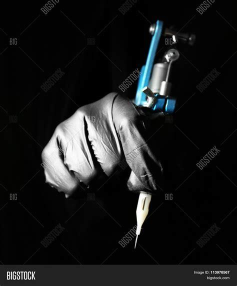 tattoo machine photography tattoo artist holding tattoo image photo bigstock
