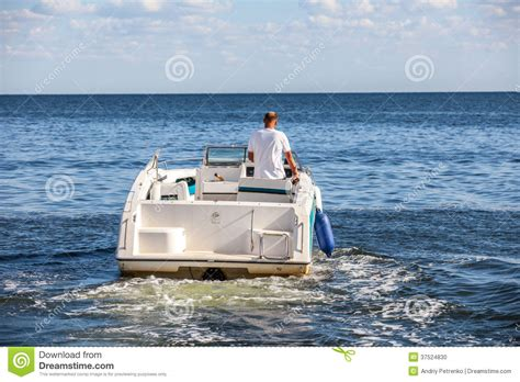 boat driving man man driving a fast boat stock photo image 37524830