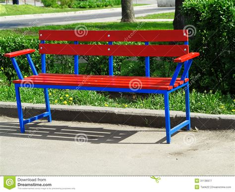 park bench productions red bench in the park royalty free stock photography