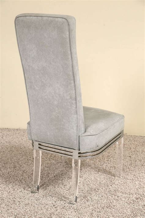 four dining chairs with velour fabric lucite legs and