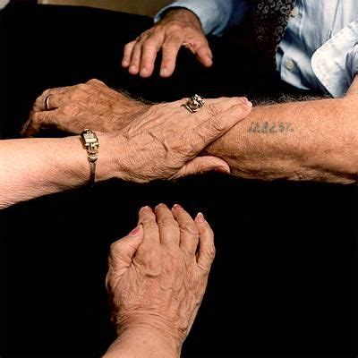 did the nazis tattoo numbers on babies frieda radasky holds the arm of her husband solomon