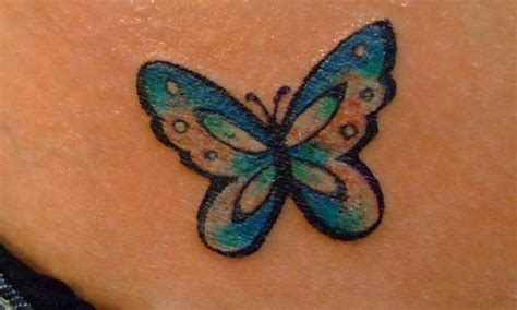 small butterfly tattoos on back pin small bumblebee on foot on