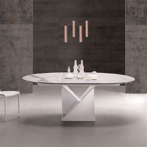 table ronde extensible design pied central  plateau