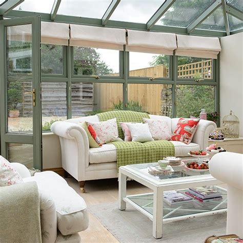 conservatory interior ideas uk green conservatory with sofas decorating