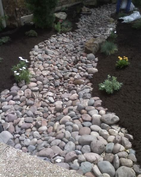 landscaping with river rock creek bed traditional landscape by lawn sculptors