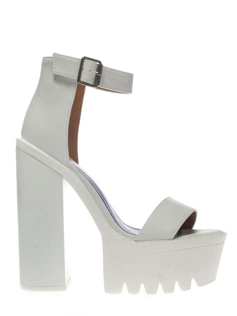white cleated sole platform shoes